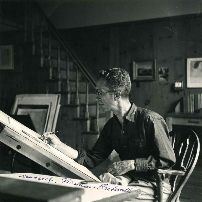 Photograph of Norman Rockwell in his studio, signed by Norman Rockwell (1894-1978). Norman Rockwell.